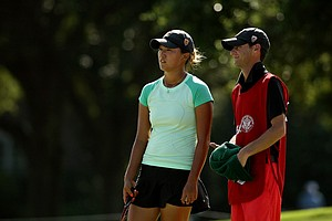 Annie Park with her caddie Justin Silverstein, assistant coach at USC, defeated Kelly Shon 1 up during the Round of 16 match play at the 2013 U. S. Women's Amateur. Park will face Yueer Cindy Feng in the quarterfinals