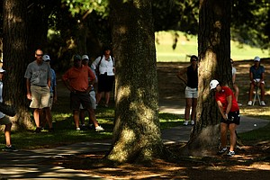 Su-Hyun Oh hits from the trees at No. 12 during the Round of 16 match play at the 2013 U. S. Women's Amateur. Oh will face Talley in the quarterfinals.