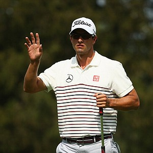 Adam Scott waves after making a putt for birdie on the eighth hole during the first round of the PGA Championship.