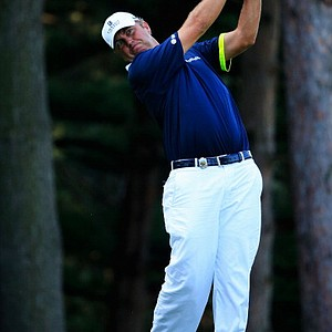 Bo Van Pelt hits his tee shot on the fourth hole during the first round of the 95th PGA Championship.