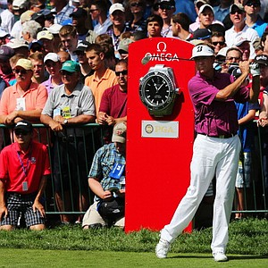 Davis Love III waits to play his tee shot on the first hole during the first round of the 95th PGA Championship.