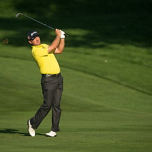 Graeme McDowell hits a shot on No. 10 during the first round of play at the 95th PGA Championship.