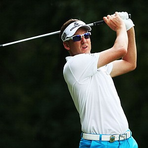 Ian Poulter hits his tee shot on the third hole during the first round of the 95th PGA Championship in Rochester, N.Y.