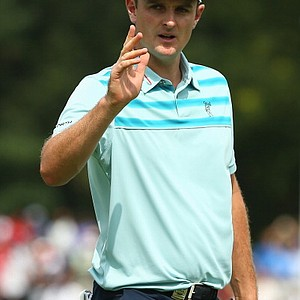 Justin Rose waves after putting on the sixth hole during the first round of the PGA Championship in Rochester, N.Y.