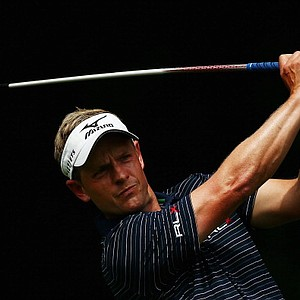 Luke Donald hits his tee shot on the fifth hole during the first round of the 95th PGA Championship in Rochester, N.Y.