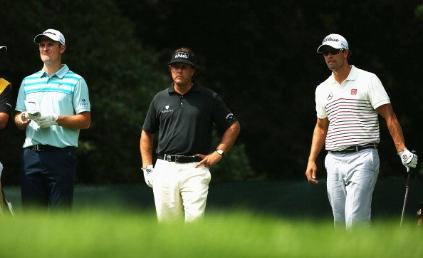 Justin Rose, Phil Mickelson and Adam Scott wait on the fifth tee during the first round of the 95th PGA Championship.