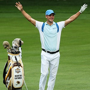 Martin Kaymer celebrates after holing a shot for eagle on the par 5 13th hole during the first round of the 95th PGA Championship.