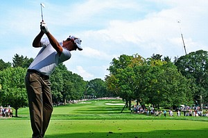 Nicolas Colsaerts hits his tee shot on the 12th hole during the first round of the PGA Championship.