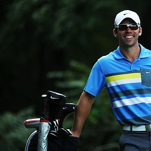 Paul Casey smiles before hitting his tee shot on the third hole during the first round of the PGA Championship.