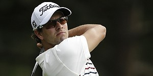 Scott flirts with history, settles for share of PGA lead