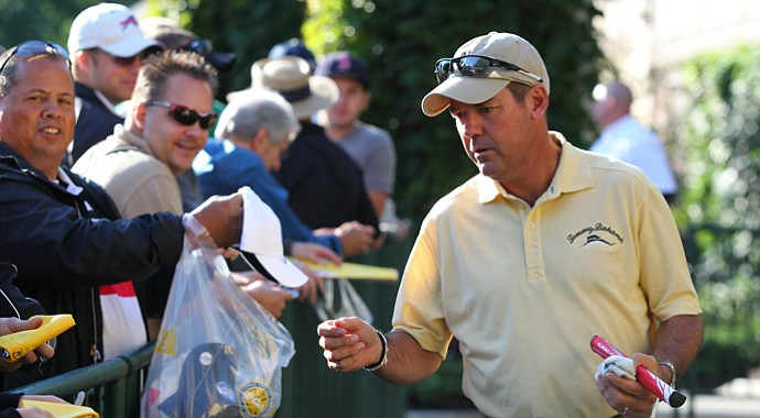 Rich Beem signs autographs during early-week preparation for the 2013 PGA Championship at Oak Hill.