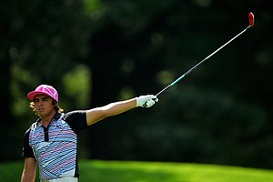 Rickie Fowler reacts to his shot on the fourth hole during the first round of the 95th PGA Championship.