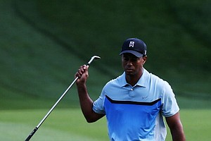 Tiger Woods reacts to a shot on the 14th hole during the first round of the PGA Championship Rochester, N.Y.