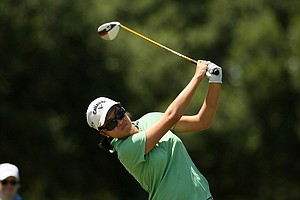 Yueer Cindy Feng hits her tee shot at No. 2 during the quarterfinals of match play at the 2013 U. S. Women's Amateur at Country Club of Charleston.