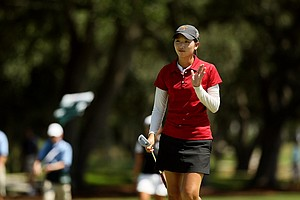 Doris Chen acknowledges the crade after sticking her shot close at No. 7 during the quarterfinals of match play at the 2013 U. S. Women's Amateur at Country Club of Charleston.