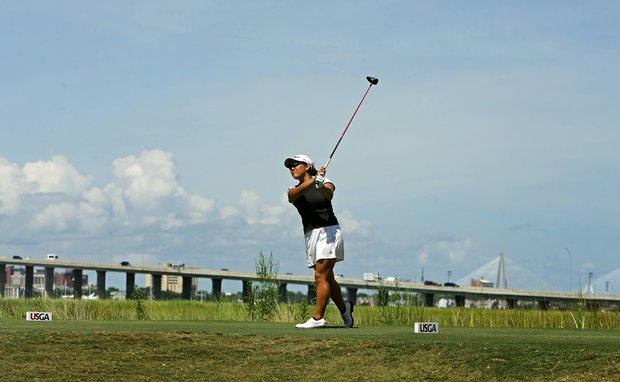 Lauren Diaz -Yi hits her tee shot at No. 8 with the Charleston Harbor in the background during the quarterfinals of match play at the 2013 U. S. Women's Amateur at Country Club of Charleston.
