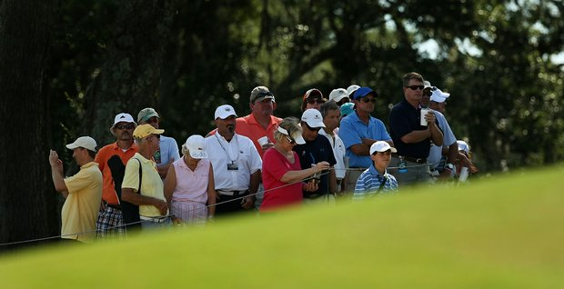 Spectators watch from behind the 11th green during the quarterfinals of match play at the 2013 U. S. Women's Amateur at Country Club of Charleston.