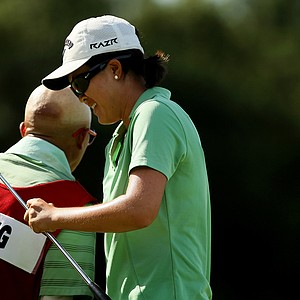 Yueer Cindy Feng gets congratulated by her dad/caddie, Delin, after she defeated Annie Park 6 and 4 during the quarterfinals of match play at the 2013 U. S. Women's Amateur at Country Club of Charleston.