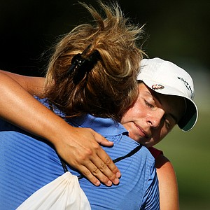 Katelyn Sepmoree gets hugs after she was defeated by Alison Lee, 4 and 3, during the quarterfinals of match play at the 2013 U. S. Women's Amateur at Country Club of Charleston.