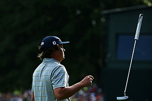 Jason Dufner tosses his putter on the 18th green after shooting a seven-under par 63 during the second round of the 95th PGA Championship.