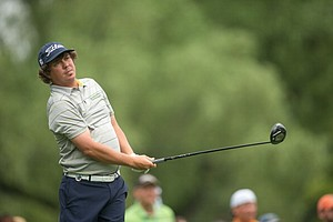 Jason Dufner watches his tee shot on the ninth hole during the second round of play at the 95th PGA Championship.