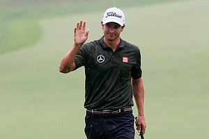 Adam Scott waves to the gallery after making birdie on the tenth hole during the second round of the PGA Championship in Rochester, N.Y.
