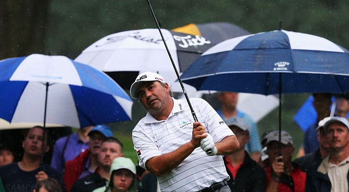 Angel Cabrera watches his tee shot on the 11th hole during the second round of the 95th PGA Championship.