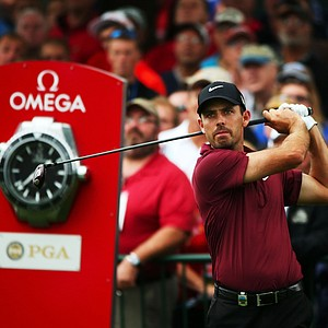 Charl Schwartzel watches his tee shot on the first hole during the second round of the 95th PGA Championship in Rochester, N.Y.
