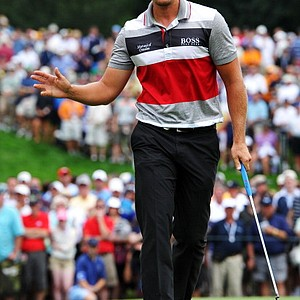 Henrik Stenson waves from the fifth green during the second round of the 95th PGA Championship in Rochester, N.Y.
