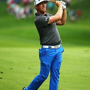 Hunter Mahan watches his approach shot on the first hole during the second round of the PGA Championship in Rochester, N.Y.