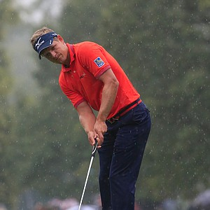 Luke Donald putts on the tenth green during the second round of the 95th PGA Championship.