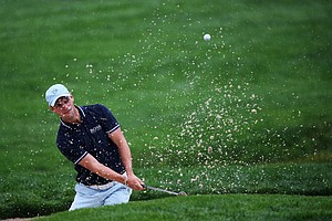 Martin Kaymer plays a shot from a bunker on the 11th hole during the second round of the 95th PGA Championship.