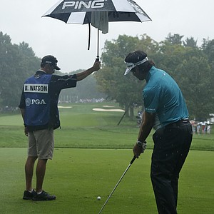 Bubba Watson gets an assist from his caddie during practice at the 2013 PGA Championship at Oak Hill.