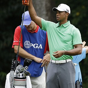 Tiger Woods and caddie Joe LaCava during the 2013 PGA Championship at Oak Hill.