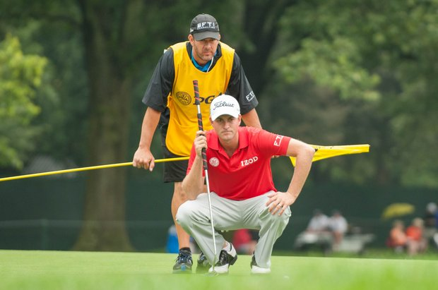 Webb Simpson gets an assist reading a putt during the 2013 PGA Championship at Oak Hill.