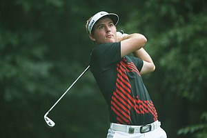 Russell Henley hits his tee shot on the third hole during the second round of the 95th PGA Championship.
