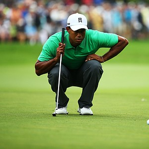 Tiger Woods lines up a putt on the first green during the second round of the 95th PGA Championship.