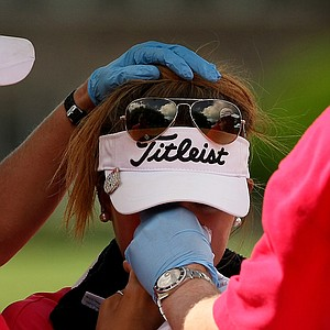 Alison Lee is tended to by medics for a nosebleed during the semifinals of match play at the 2013 U. S. Women's Amateur at Country Club of Charleston.