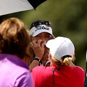 Alison Lee is tended to by paramedics for a nosebleed after the third hole during the semifinals of match play at the 2013 U. S. Women's Amateur at Country Club of Charleston.