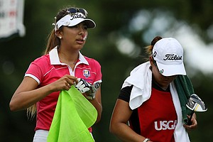 Alison Lee and her caddie Lauren Diaz-Yi leave the 4th tee while trying to manage her nose bleed during the semifinals of match play at the 2013 U. S. Women's Amateur at Country Club of Charleston.