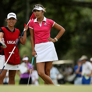 Lauren Diaz-Yi, who was knoced out of the quarterfinals, caddied for Alison Lee during the semifinals of match play at the 2013 U. S. Women's Amateur at Country Club of Charleston.
