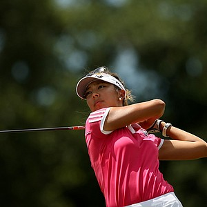 Alison Lee hits her tee shot at No. 9 during the semifinals of match play at the 2013 U. S. Women's Amateur at Country Club of Charleston.