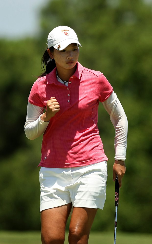 Doris Chen celebrates her putt at No. 16 during the semifinals of match play at the 2013 U. S. Women's Amateur at Country Club of Charleston.