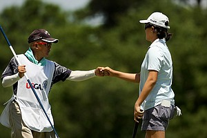 Yueer Cindy Feng gets a fist bump from her dad, Delvin, during the semifinals of match play at the 2013 U. S. Women's Amateur at Country Club of Charleston.