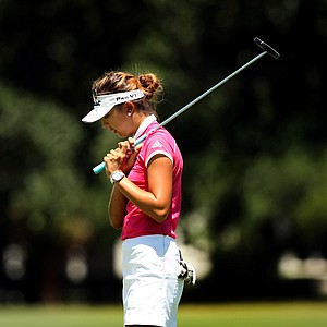 Alison Lee reacts to missing her putt at No. 17 during the semifinals of match play at the 2013 U. S. Women's Amateur at Country Club of Charleston.