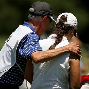 Emma Talley gets a hug from her dad, Dan, during the semifinals of match play at the 2013 U. S. Women's Amateur at Country Club of Charleston.