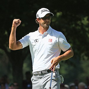 Adam Scott celebrates after a birdie putt on the first green during the third round of the PGA Championship in Rochester, N.Y.