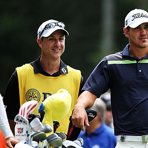 Brooks Koepka waits with his caddie, Rickey Elliott, during the third round of the 95th PGA Championship.