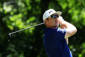 Hunter Mahan hits his tee shot on the third hole during the third round of the 95th PGA Championship.