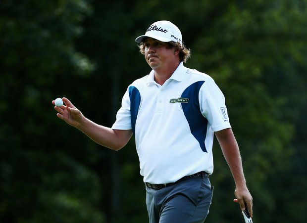 Jason Dufner waves to the gallery on the second hole during the third round of the PGA Championship.